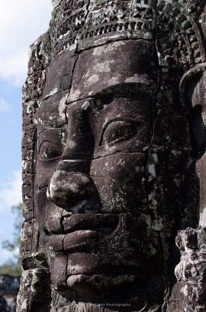 Giant stone face of Lokeshvara, Bayon Temple of Angkor Thom