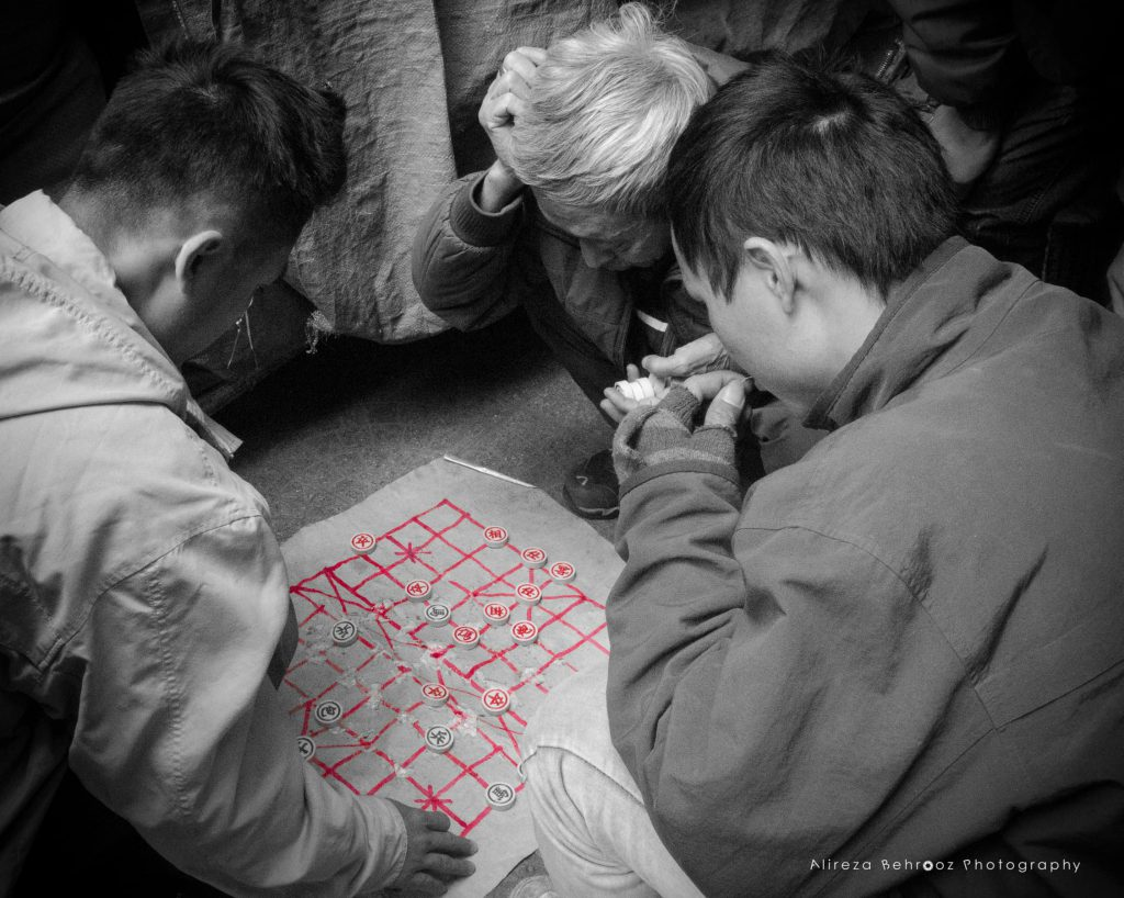 Playing  xiangqi on the streets of Old Quarter, Hanoi, Vietnam