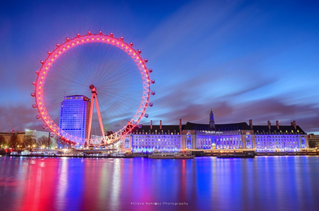 London Eye and town hall at night over River Thames