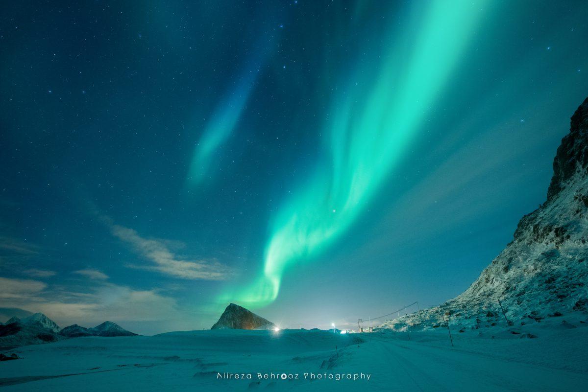 Aurora borealis over Offersøykammen mountain near Napp, Lofoten