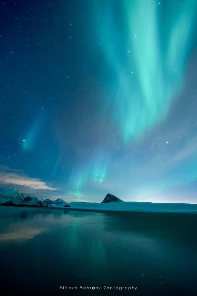 Nortern lights reflected in the sandy Storsandnes beach, Lofoten